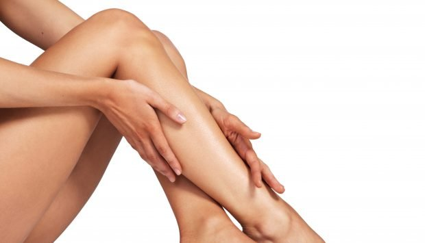 Patient admires smooth skin on legs