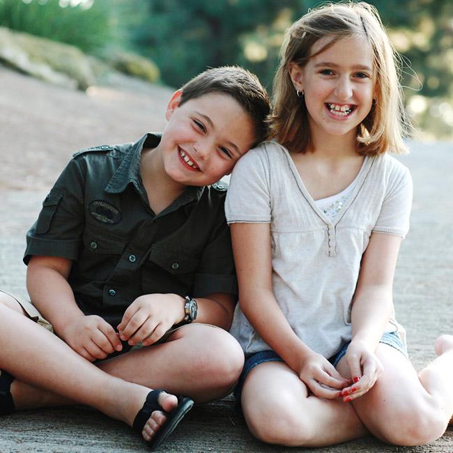 A young boy and girl having fun
