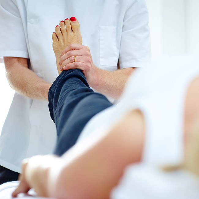 Chiropractor evaluating a patient's foot