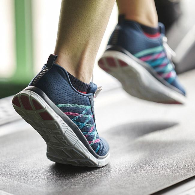 Fit person runs on treadmill.