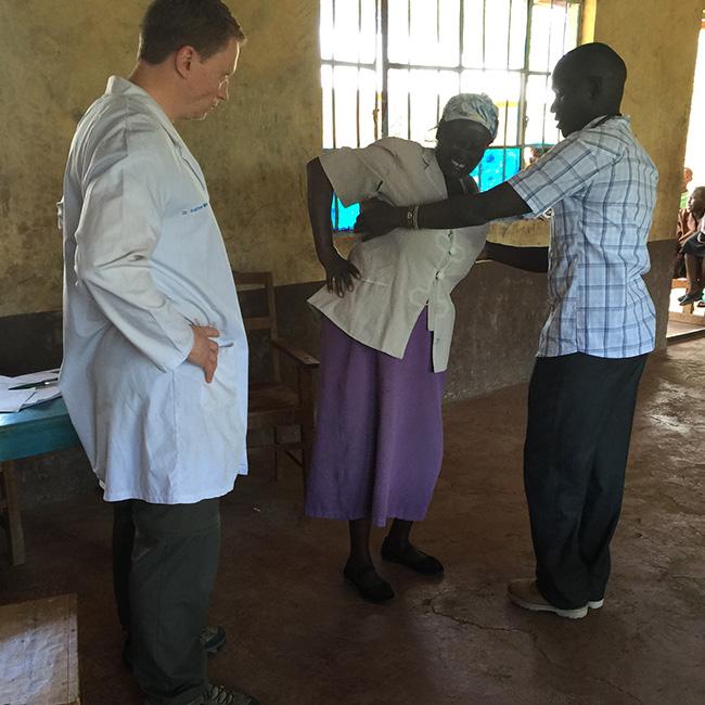 A Medcan practitioner trains a Kenyan practitioner new techniques through Medcan's Naweza program.