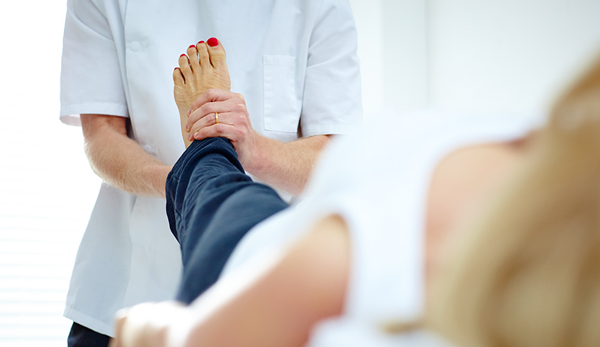 Chiropractor treating a patient's foot