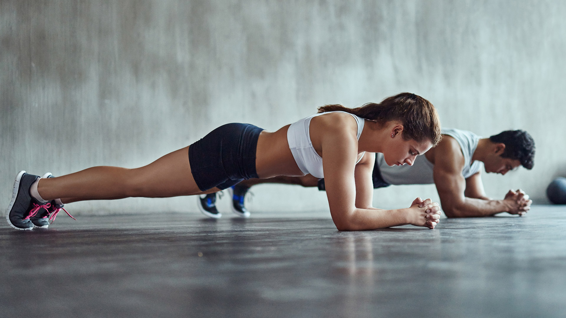 Two people perform plank exercises to increase core strength