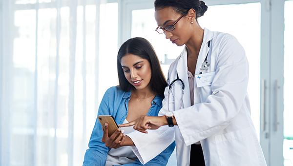 Physician walks through results in clinic with patient